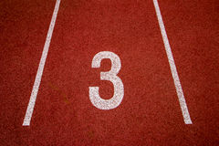 Red running track Synthetic rubber on the athletic stadium. Stock Image