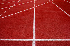 Red running track Synthetic rubber on the athletic stadium. Stock Images