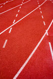 Red running track Synthetic rubber on the athletic stadium. Royalty Free Stock Photos