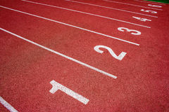 Red running track Synthetic rubber on the athletic stadium. Royalty Free Stock Photo