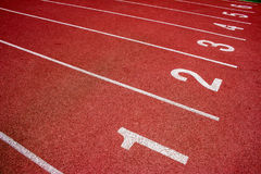 Red running track Synthetic rubber on the athletic stadium. Royalty Free Stock Images