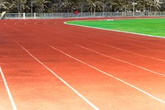 Red running track, white line in the stadium stock image