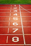 Red running tracks in sport stadium. Stock Photography