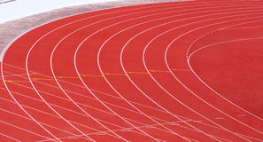 Red running tracks with white lines Royalty Free Stock Images