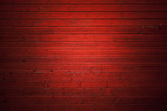 Red rural wooden wall, close-up background Stock Photo