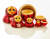 Red russian nesting dolls isolated on a white background. Matryoshka doll, also known as a Russian nesting doll, Stacking dolls, or Russian doll, is a set of stock photography