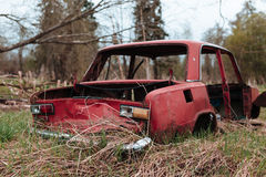 Red russian old broken car. Stock Photography