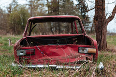 Red russian old broken car. Royalty Free Stock Images