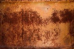 Red rust pattern on metal barrel. Textured pattern of red rust on a metal barrel Stock Image