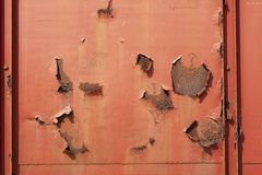 Red rusted and scratched metal surface background texture. Image royalty free stock photos