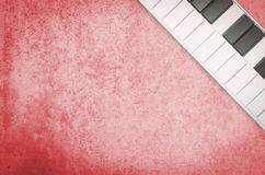 Red rustic background with music keyboard Stock Image