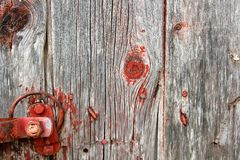 Red Rustic Barn Wood Background with Latch Hardware Stock Images