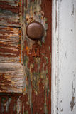 Red Rustic Door with White Frame royalty free stock image