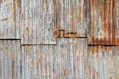 Red rusty corrugated iron sheets Stock Photo