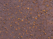 Red rusty grungy old metal texture. Old metal texture with round holes Royalty Free Stock Photo