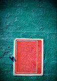 Red rusty grungy old sign with vignette on a cement wall Stock Image