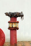 Red rusty metal industrial water pipes with a valve. Stock Images