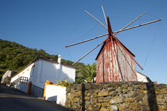 Red rusty windmill in Azores. Sao Jorge island. Portugal. Horizontal Royalty Free Stock Photos