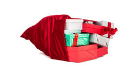 Red sack full of gifts Stock Images