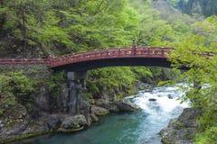 Red sacred bridge Shinkyo in UNESCO site of Nikko, Japan Stock Photos