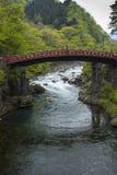 Red sacred bridge Shinkyo in UNESCO site of Nikko, Japan Stock Photography