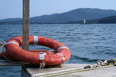 Red safe guard life ring. And sea stock photos