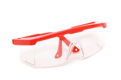 Red safety glasses isolated. On the white background Royalty Free Stock Photos