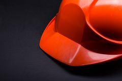 Red safety helmet. On black Royalty Free Stock Photos