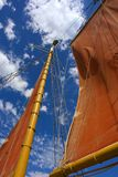 Red sail against skies Royalty Free Stock Photos