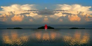 Red sail.Golden Lake. Stock Image