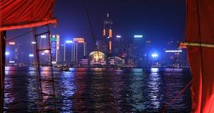 Red-sail junk boat. Hong Kong, China - January 1, 2016: 4K panorama of skyline with Aqua Luna red-sail junk boat from Tsim Sha Tsui in Kowloon. landmarks Central stock video footage
