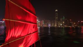 Red-sail junk boat skyline. Hong Kong, China - December 1, 2016: Time lapse skyline with Aqua Luna red-sail junk boat from Tsim Sha Tsui in Kowloon. landmarks stock footage