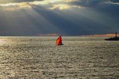 Red sail in sea at sunset Royalty Free Stock Photos