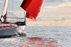 Red sail at sunset Stock Photography