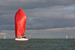 Red sail at sunset Stock Photo