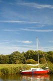 Red sail on the water. A scene at the english norfolk broads Royalty Free Stock Photography