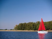 Red sail yacht stock images