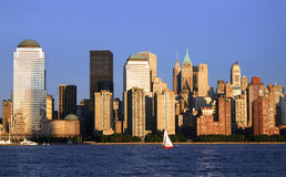 Red Sailboat. Lower Manhattan at sunset Royalty Free Stock Images