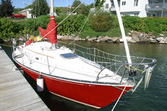 Red Sailboat. A Red sailboat tied up at a dock Stock Image