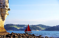 Red sailboat on Tejo river Stock Image