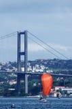 Red sailing  boat and bridge. Red sailing boat and bospurus bridge Stock Photos