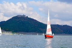 Red sailing boat on the Edersee Stock Image