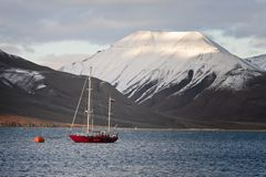 Red sailing boat to the buoy, Svalbard, Norway Stock Photo