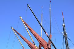 Red sails furled on jibs. Of thames yacht Stock Photography