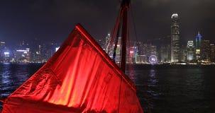 Red sails Hong Hong. Hong Kong, China - December 1, 2016: the red sails of typical junk boat in Hong Hong skyline. Aqua Luna red-sail boat from Tsim Sha Tsui in stock video footage