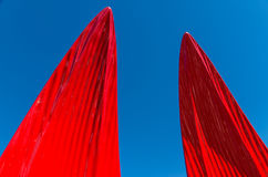 Red sails reaching towards the sky Stock Photo