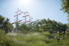 Red sails among trees Stock Photo