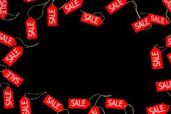 Red sale and discount shop labels isolated on black bakcground with space for text during black friday holiday in fashion shop. Store shopping mall with sale royalty free stock photography