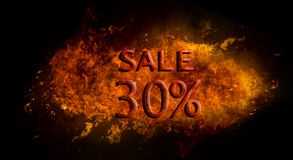 Red Sale 30%  on fire flame explosion, black background Royalty Free Stock Images