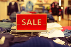 Red sale sign in the boutique shop Stock Image
